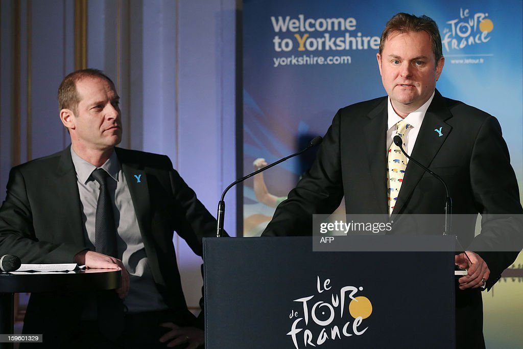 General director of the Tour de France Christian Prudhomme (L) listens to a speech by CEO of Welcome to Yorkshire Gary Verity, on January 17, 2013 in Paris, during the official presentation of the 2014 Tour de France's 'Grand depart' (Great departure). The 2014 Tour de France will start with a stage between Leeds and Harrogate in the northern English county of Yorkshire on July 5, organisers of cycling's most prestigious and gruelling race announced today.