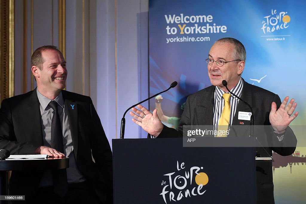 General director of the Tour de France Christian Prudhomme (L) listens to sir Peter Heny, commissioner of Transports for London, on January 17, 2013 in Paris, during the official presentation of the 2014 Tour de France's 'Grand depart' (Great departure). The 2014 Tour de France will start with a stage between Leeds and Harrogate in the northern English county of Yorkshire on July 5, organisers of cycling's most prestigious and gruelling race announced today. AFP PHOTO / THOMAS SAMSON