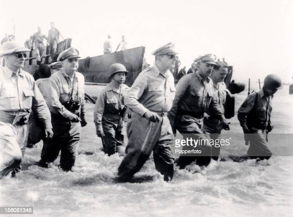 General Douglas MacArthur and his staff wade ashore during intitial landings of United States forces at Leyte in the Philippines during World War Two...
