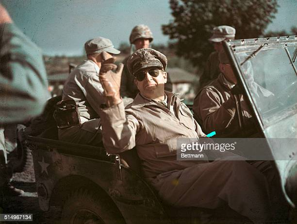 General Douglas MacArthur Riding in Jeep