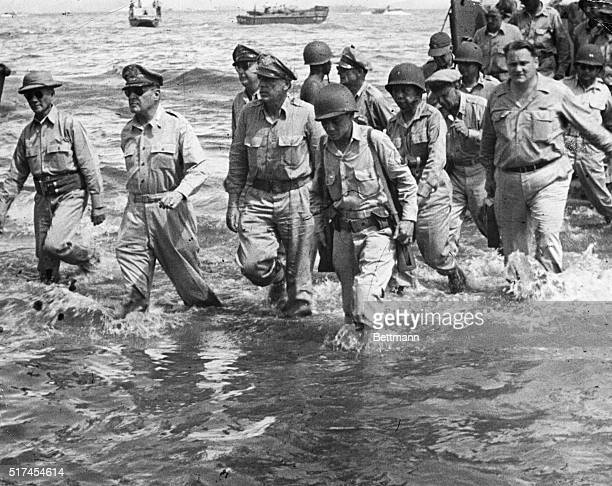General Douglas MacArthur walks to the shore of Leyte Island with a group of US Army and Philippine officers