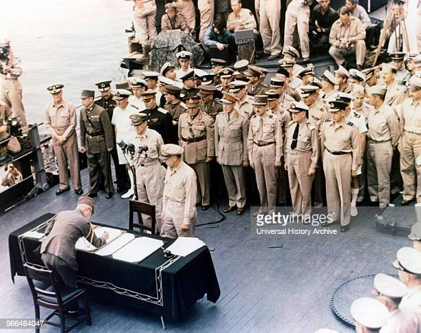 General Douglas MacArthur watches as representatives of Japan stand aboard USS Missouri prior to signing of the Instrument of Surrender ending World...