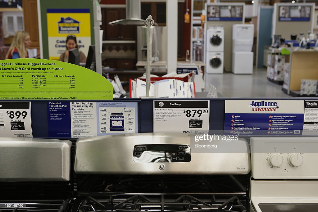 A General Electric Co. (GE) gas range, center, is displayed for sale at a Lowe's Cos. store in Torrance, California, U.S, on Thursday, Oct. 17, 2013. General Electric Co. is scheduled to release earnings figures on Oct. 18. Photographer: Patrick T. Fallon/Bloomberg via Getty Images