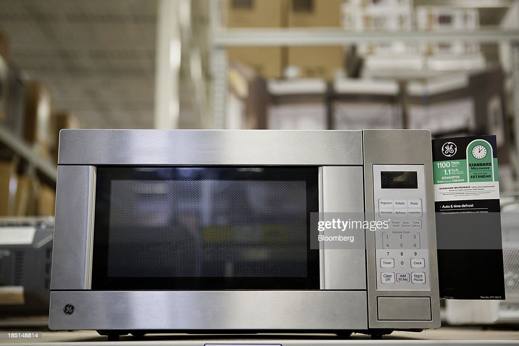 a general electric co ge microwave oven is displayed for sale at a