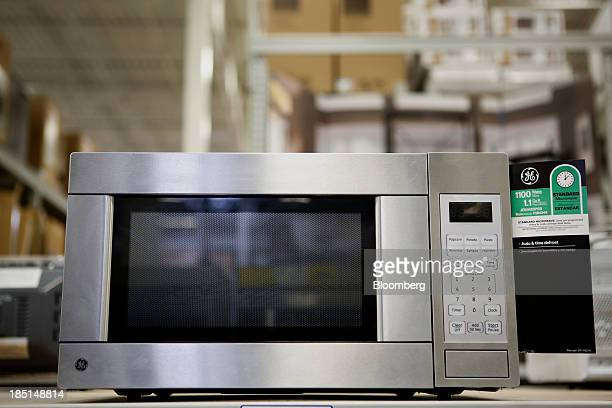 A General Electric Co microwave oven is displayed for sale at a Lowe's Cos store in Torrance California US on Thursday Oct 17 2013 General Electric...