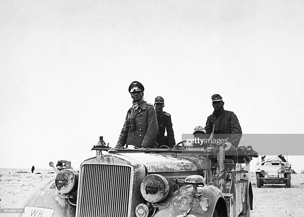 General Erwin Rommel, known as the 'Desert Fox,' rides through the desert between Tobruk and Sidi Omar in Libya. Rommel led the Afrika Corps' 15th Panzer Division to victories throughout 1940 and 1941, but was finally defeated by the British at El Alamein in 1942.