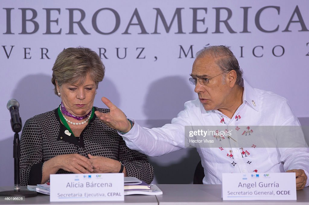 General Executive of CEPAL Alicia Barcena and OECD General Secretary Angel Gurria during the XXIV Ibero-American Summit Veracruz 2014 at World Trade Center on December 09, 2014 in Veracruz, Mexico. The Ibero-American Summit is comprised by the 22 members of the Organization of Ibero-American States, and this year the heads of State and Governments will discuss issues in education, innovation and culture.