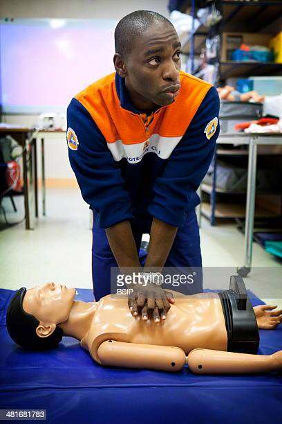 General First Aid course run by a French civil defense unit in Paris France CPR on a training mannequin