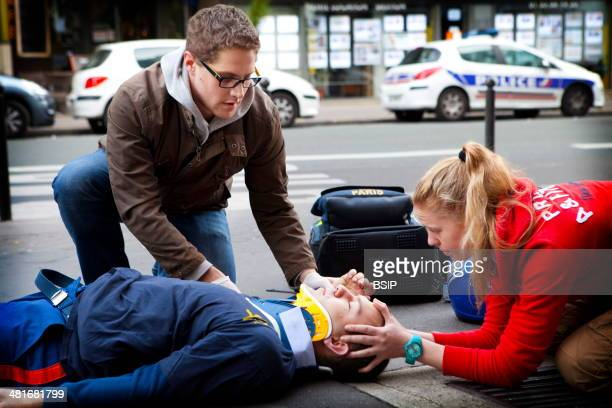 General First Aid course run by a French civil defense unit in Paris France Practical situation placing a neck brace