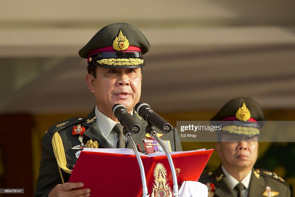 General Gen. <a gi-track='captionPersonalityLinkClicked' href=/galleries/search?phrase=Prayuth+Chan-ocha&family=editorial&specificpeople=12820257 ng-click='$event.stopPropagation()'>Prayuth Chan-ocha</a>, Commander in Chief of the Royal Thai Army, center, addresses his troops at their barracks on Thailand's Armed Forces Day on January 18, 2014 in Bangkok, Thailand. Thailand's military, a powerful force in Thai society, has so far declined to become involved in Thailand's protracted political crisis