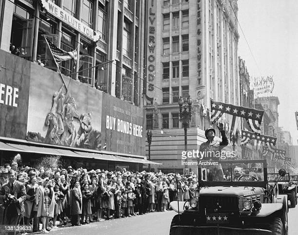 General George S Patton acknowledges the cheers of the welcoming crowds while riding in a parade through the streets of Los Angeles CA June 9 1945...