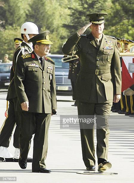 US General James Jones commander of NATO forces in Europe salutess Turkish soldiers as Turkish army chief Hilmi Ozkok walks alongside during Jones...