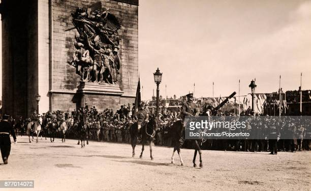 General John J Pershing commander of the American Expeditionary Forces on the Western Front leads his troops through the Arc de Triomphe during the...
