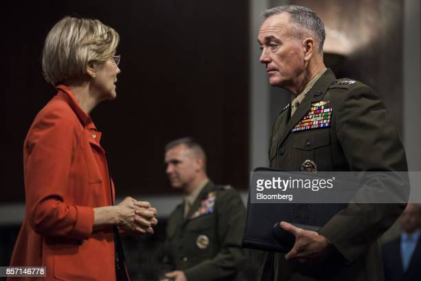 General Joseph Dunford chairman of the Joint Chiefs of Staff speaks with Senator Elizabeth Warren a Democrat from Massachusetts after testifying...