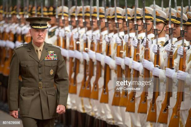 General Joseph Dunford chairman of the US Joint Chiefs of Staff reviews an honour guard during a welcoming ceremony in Beijing on August 15 2017 /...