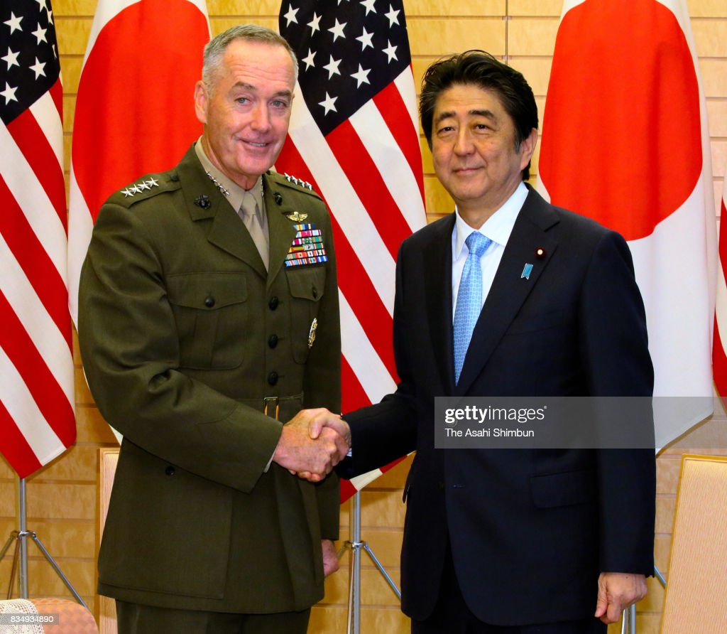 General Joseph Dunford, chairman of the U.S. Joint Chiefs of Staff and Japanese Prime Minister Shinzo Abe shake hands during their meeting at Abe's official residence on August 18, 2017 in Tokyo, Japan.