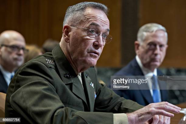 General Joseph Dunford chairman of the US Joint Chiefs of Staff speaks as James Mattis US secretary of defense right listens during a Senate...