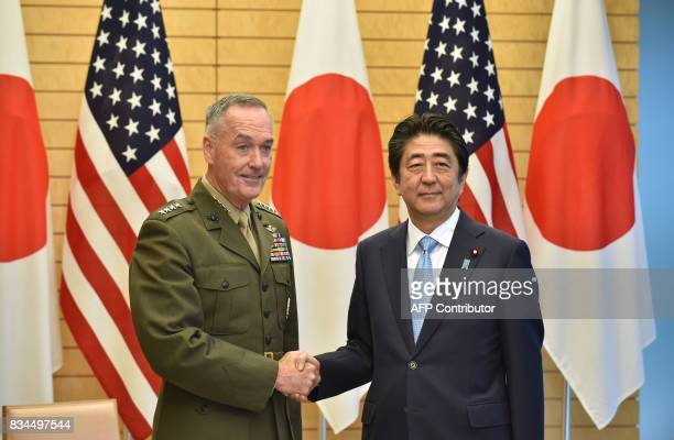 General Joseph Dunford chairman of the US Joint Chiefs of Staff shakes hands with Japan's Prime Minister Shinzo Abe at Abe's official residence in...