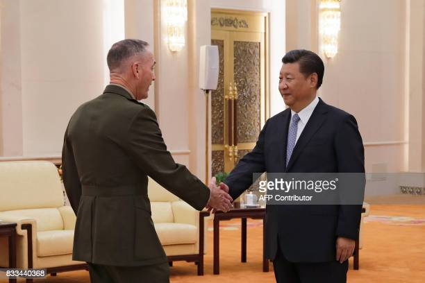 General Joseph Dunford the chairman of the US joint chiefs of staff shakes hands with China's President Xi Jinping at the Great Hall of the People in...