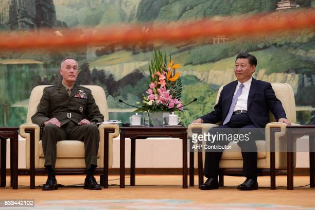 General Joseph Dunford the chairman of the US joint chiefs of staff meets China's President Xi Jinping at the Great Hall of the People in Beijing on...