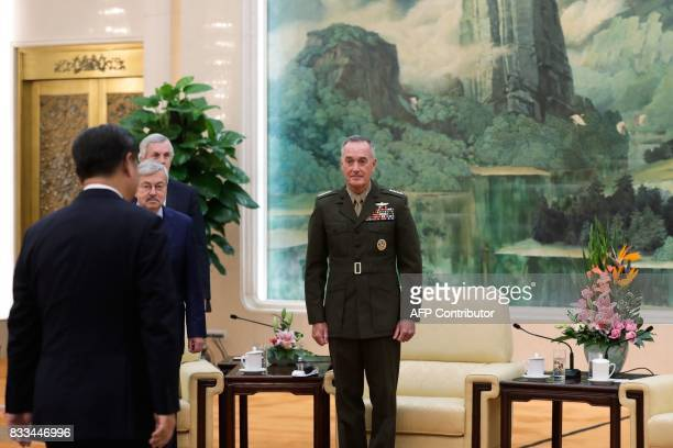 General Joseph Dunford the chairman of the US joint chiefs of staff and US Ambassador to China Terry Branstad watch as China's President Xi Jinping...