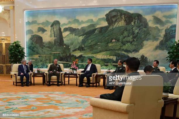 General Joseph Dunford the chairman of the US joint chiefs of staff talks with China's President Xi Jinping during a meeting at the Great Hall of the...