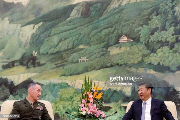 General Joseph Dunford the chairman of the US joint chiefs of staff listens to China's President Xi Jinping during a meeting at the Great Hall of the...