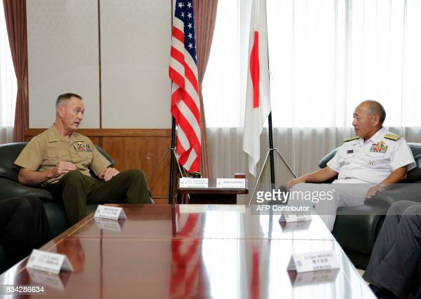 General Joseph Dunford the chairman of the US Joint Chiefs of Staff talks with Japan's Chief of Staff of Joint Staff Katsutoshi Kawano at the Defence...