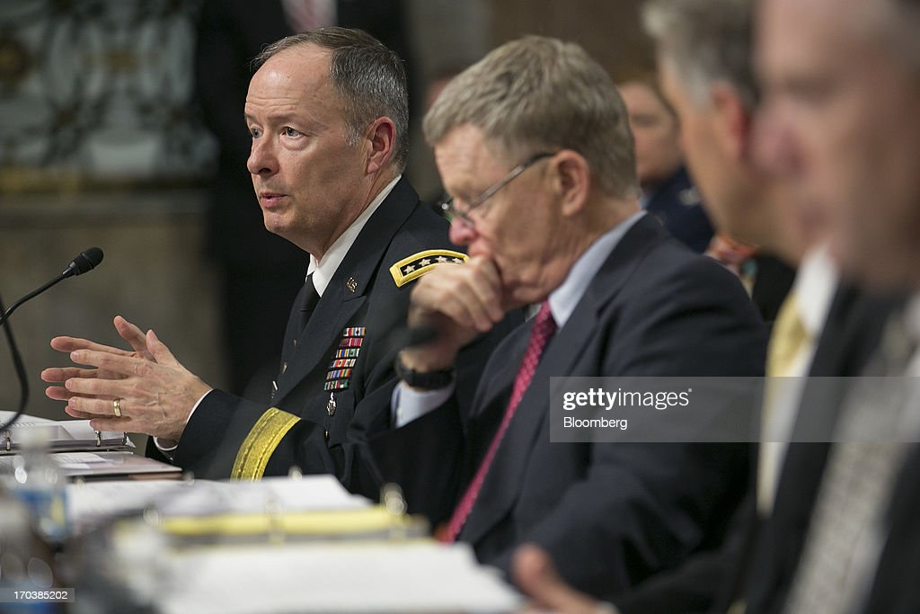 General Keith Alexander, director of the National Security Agency and commander of the U.S. Cyber Command, left, speaks during a Senate Appropriations Committee hearing with Rand Beers, acting deputy secretary at the Department of Homeland Security (DHS), center, in Washington, D.C., U.S., on Wednesday, June 12, 2013. Americans need to trust the government isn't violating their civil rights after a 29-year-old contractor exposed classified programs to collect broad Internet and telephone-call data, the National Security Agency's director said. Photographer: Andrew Harrer/Bloomberg via Getty Images