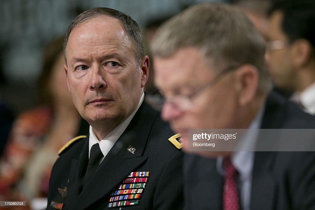 General Keith Alexander, director of the National Security Agency and commander of the U.S. Cyber Command, left, listens as Rand Beers, acting deputy secretary at the Department of Homeland Security (DHS), speaks during a Senate Appropriations Committee hearing in Washington, D.C., U.S., on Wednesday, June 12, 2013. Americans need to trust the government isn't violating their civil rights after a 29-year-old contractor exposed classified programs to collect broad Internet and telephone-call data, the National Security Agency's director said. Photographer: Andrew Harrer/Bloomberg via Getty Images