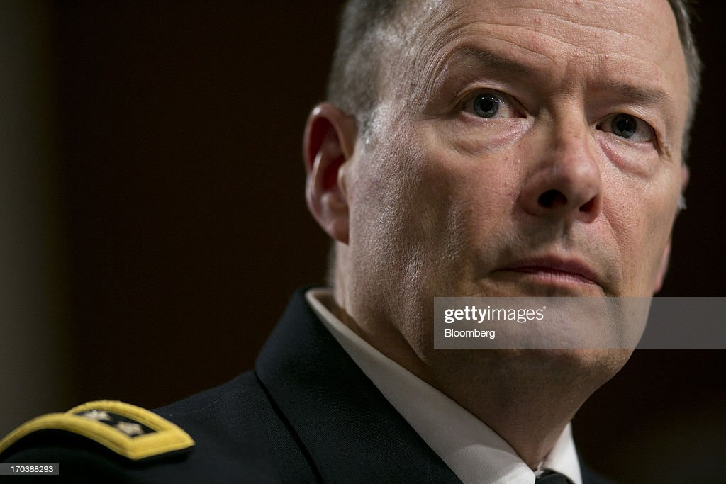 General Keith Alexander, director of the National Security Agency and commander of the U.S. Cyber Command, listens during a Senate Appropriations Committee hearing in Washington, D.C., U.S., on Wednesday, June 12, 2013. Americans need to trust the government isn't violating their civil rights after a 29-year-old contractor exposed classified programs to collect broad Internet and telephone-call data, the National Security Agency's director said. Photographer: Andrew Harrer/Bloomberg via Getty Images