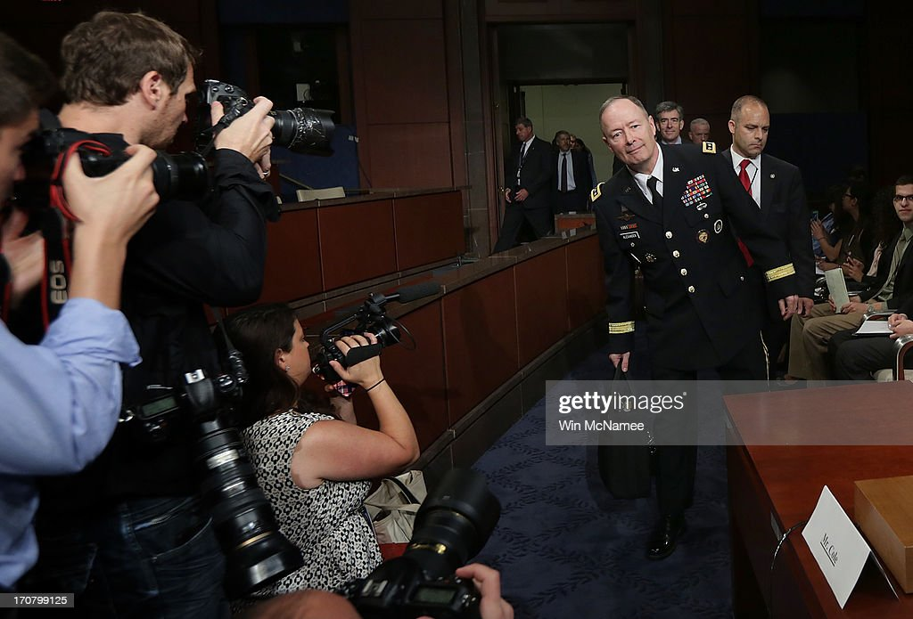 General Keith Alexander, director of the National Security Agency, arrives for testimony before the House Select Intelligence Committee June 18, 2013 in Washington, DC. The committee heard testimony on the topic of 'how the disclosed NSA programs protect Americans from terror attacks on US soil, and why the disclosure of that classified information aids our adversaries.'