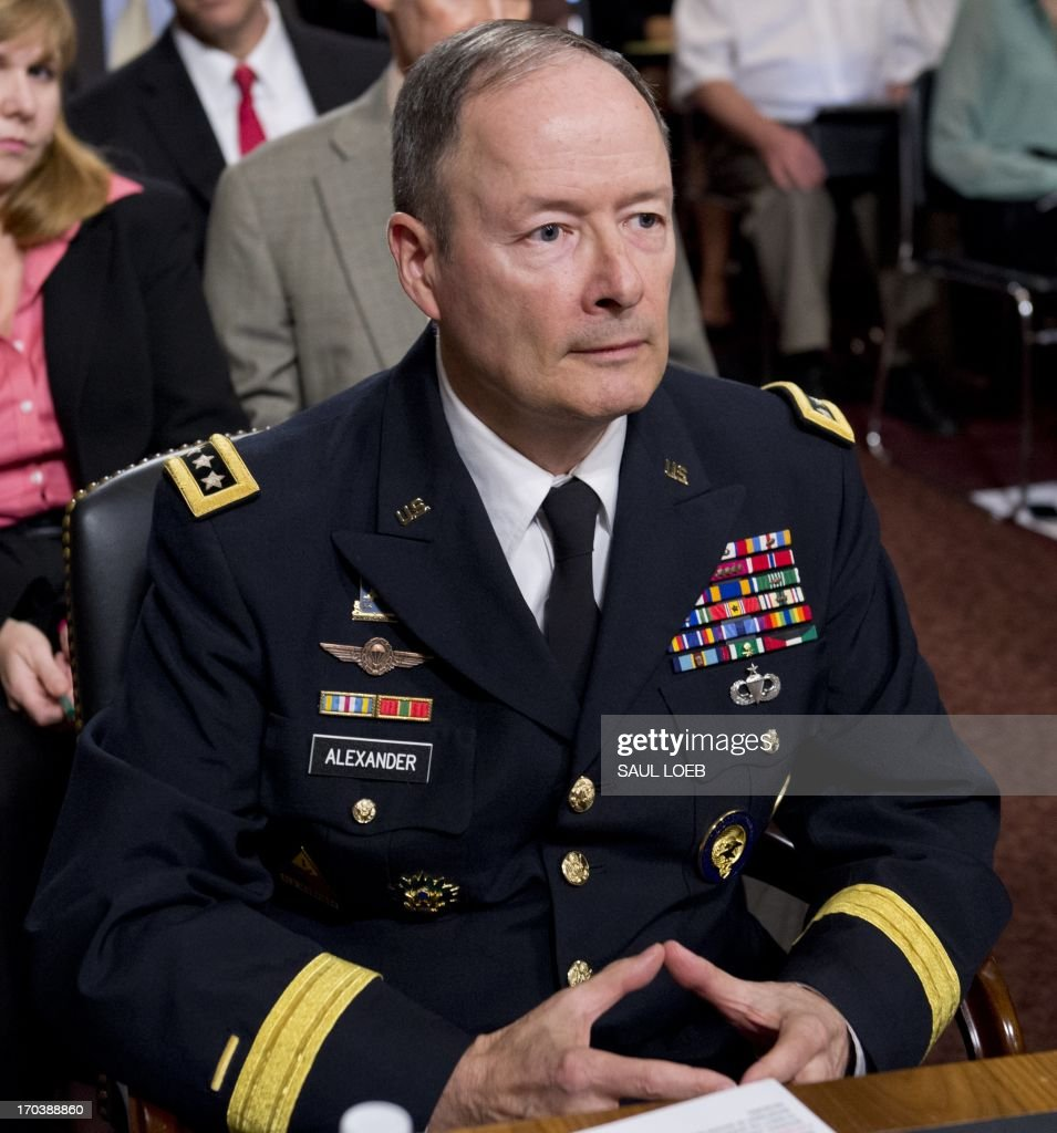 General Keith Alexander, director of the National Security Agency (NSA), commander of the US Cyber Command and chief of the Central Security Service arrives to testify before the Senate Appropriations Committee on cyberthreats during a hearing on Capitol Hill in Washington, DC, June 12, 2013. AFP PHOTO / Saul LOEB