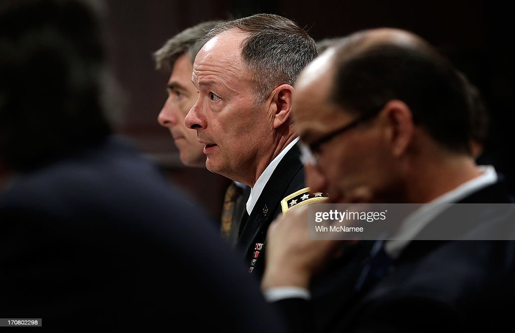 General Keith Alexander (C), Director of the National Security Agency, testifies before the House Select Intelligence Committee June 18, 2013 in Washington, DC. The committee heard testimony on the topic of 'how the disclosed NSA programs protect Americans from terror attacks on US soil, and why the disclosure of that classified information aids our adversaries.' Also pictured are (L-R) Chris Inglis, Deputy Director of the NSA; and Sean Joyce, deputy director of the Federal Bureau of Investigation.