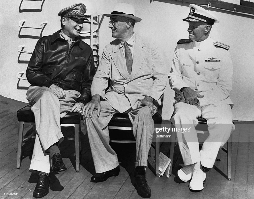 <a gi-track='captionPersonalityLinkClicked' href=/galleries/search?phrase=General+MacArthur&family=editorial&specificpeople=90932 ng-click='$event.stopPropagation()'>General MacArthur</a>, President Roosevelt, and Admiral Nimitz discuss the progress of the war.