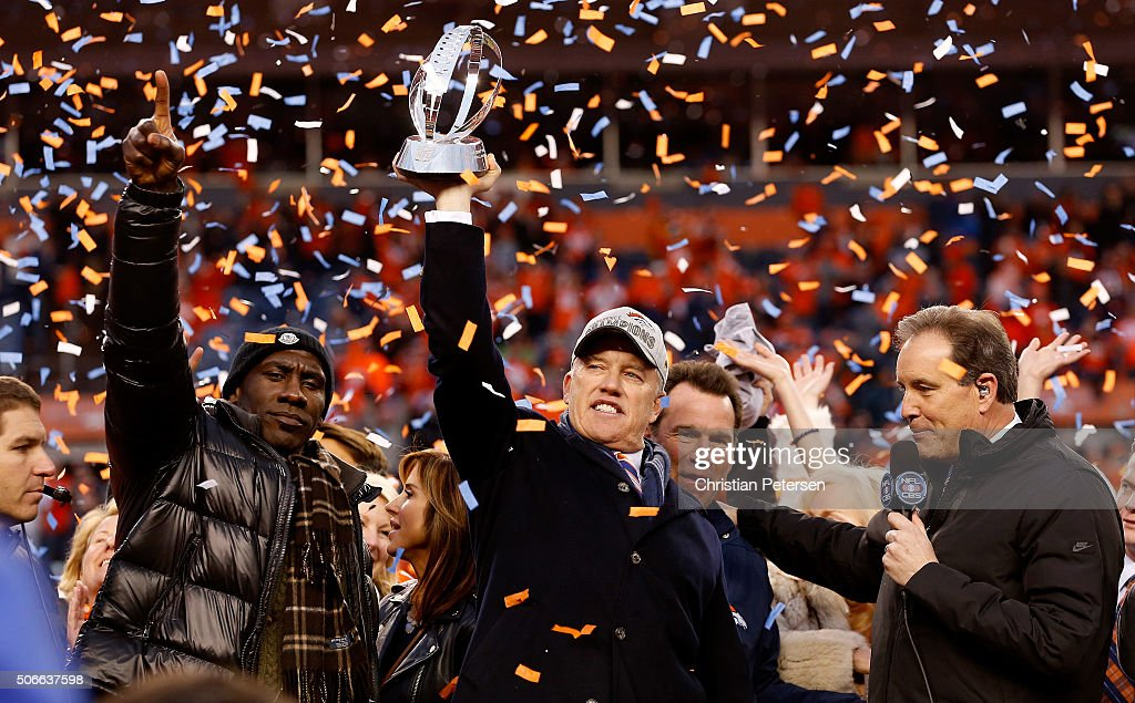 General Manager and Executive Vice President of Football Operation for the Denver Broncos <a gi-track='captionPersonalityLinkClicked' href=/galleries/search?phrase=John+Elway&family=editorial&specificpeople=204173 ng-click='$event.stopPropagation()'>John Elway</a> holds up the Lamar Hunt Trophy with former Bronco <a gi-track='captionPersonalityLinkClicked' href=/galleries/search?phrase=Terrell+Davis&family=editorial&specificpeople=207037 ng-click='$event.stopPropagation()'>Terrell Davis</a> after defeating the New England Patriots in the AFC Championship game at Sports Authority Field at Mile High on January 24, 2016 in Denver, Colorado. The Broncos defeated the Patriots 20-18.