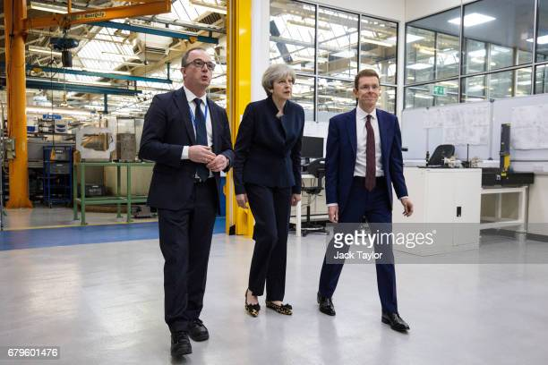 General Manager at UTC Aerospace Systems Robert Hupfer British Prime Minister Theresa May and West Midlands Mayor Andy Street tour the UTC Aerospace...