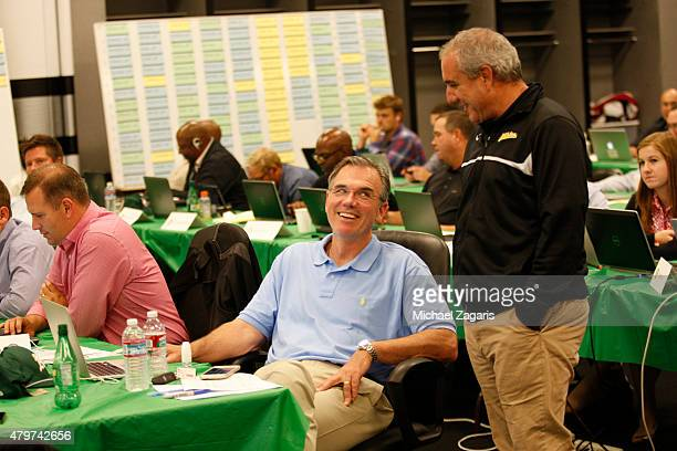 General Manager Billy Beane and Director of Professional Scouting/Baseball Development Dan Feinstein of the Oakland Athletics talk in the Athletics...