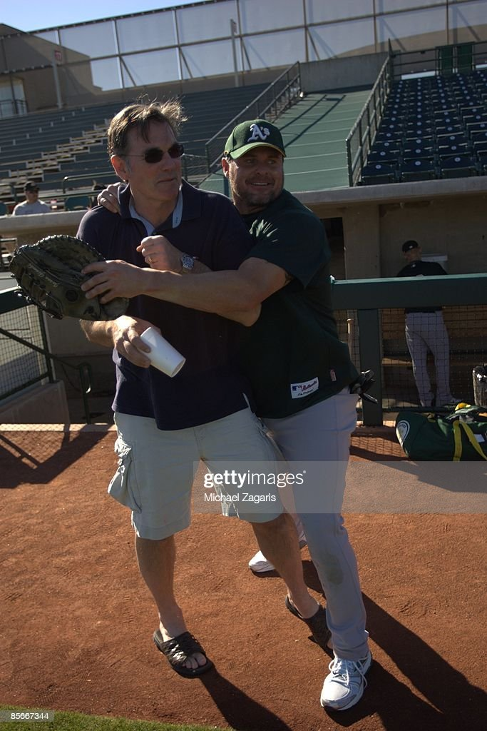 General Manager Billy Beane and Jason Giambi of the Oakland Athletics on the field prior to the game against the Milwaukee Brewers at the Maryvale...