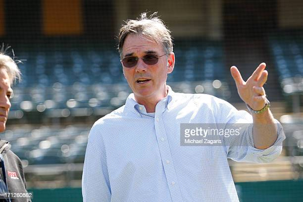 General Manager Billy Beane of Oakland Athletics watching the team first round draft pick Billy McKinney takes batting practice during a workout...