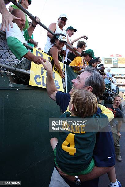 General manager Billy Beane of the Oakland Athletics celebrates with fans after defeating the Texas Rangers to clinch the AL West Division title on...