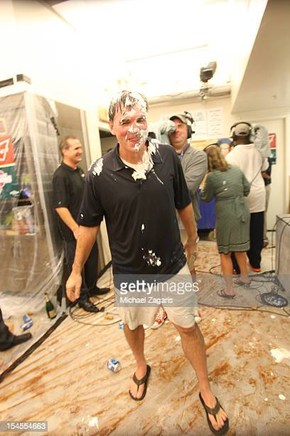 General Manager Billy Beane of the Oakland Athletics stands in the clubhouse after being pied following the game against the Texas Ranger at the...