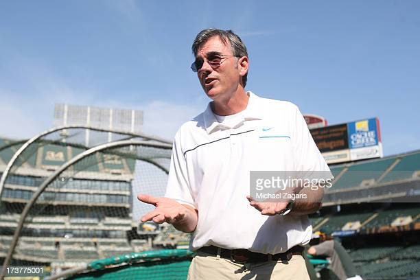 General Manager Billy Beane of the Oakland Athletics stands on the field prior to the game against the Chicago Cubs at Oco Coliseum on July 3 2013 in...