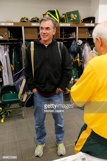 General Manager Billy Beane of the Oakland Athletics talks with Equipment Manager Steve Vucinich in the clubhouse at Hohokam Stadium on March 2 2015...