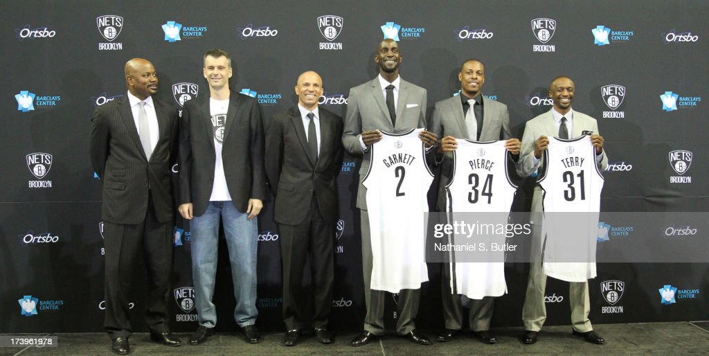 General Manager Billy King, majority owner Mikhail Prokhorov, Head Coach <a gi-track='captionPersonalityLinkClicked' href=/galleries/search?phrase=Jason+Kidd&family=editorial&specificpeople=201560 ng-click='$event.stopPropagation()'>Jason Kidd</a>, <a gi-track='captionPersonalityLinkClicked' href=/galleries/search?phrase=Kevin+Garnett&family=editorial&specificpeople=201473 ng-click='$event.stopPropagation()'>Kevin Garnett</a> #2, <a gi-track='captionPersonalityLinkClicked' href=/galleries/search?phrase=Paul+Pierce&family=editorial&specificpeople=201562 ng-click='$event.stopPropagation()'>Paul Pierce</a> #34, and <a gi-track='captionPersonalityLinkClicked' href=/galleries/search?phrase=Jason+Terry&family=editorial&specificpeople=201734 ng-click='$event.stopPropagation()'>Jason Terry</a> #31 of the Brooklyn Nets pose during a press conference at the Barclays Center on July 18, 2013 in the Brooklyn borough of New York City.