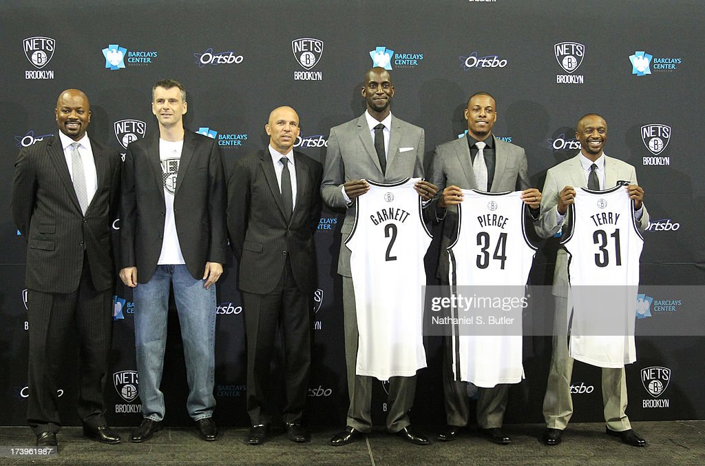 General Manager Billy King, majority owner Mikhail Prokhorov, Head Coach Jason Kidd, Kevin Garnett #2, Paul Pierce #34, and Jason Terry #31 of the Brooklyn Nets pose during a press conference at the Barclays Center on July 18, 2013 in the Brooklyn borough of New York City.