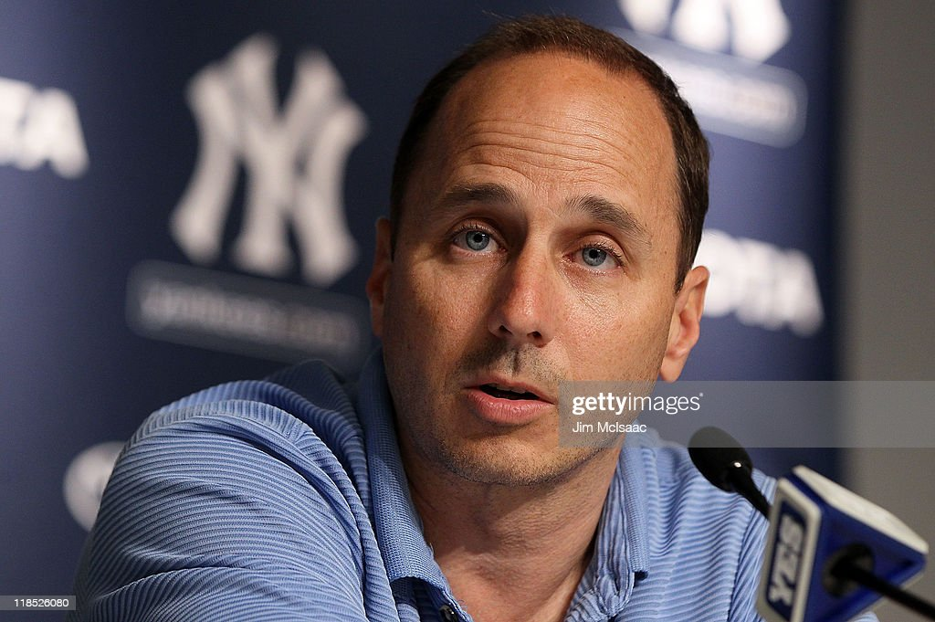 General manager Brian Cashman of the New York Yankees speaks to the media after the game against the Tampa Bay Rays was postponed due to rain on July 8, 2011 at Yankee Stadium in the Bronx borough of New York City.