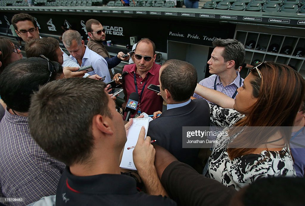 General Manager Brian Cashman of the New York Yankees talks with reporters before a game against the Chicago White Sox at U.S. Cellular Field on August 6, 2013 in Chicago, Illinois.