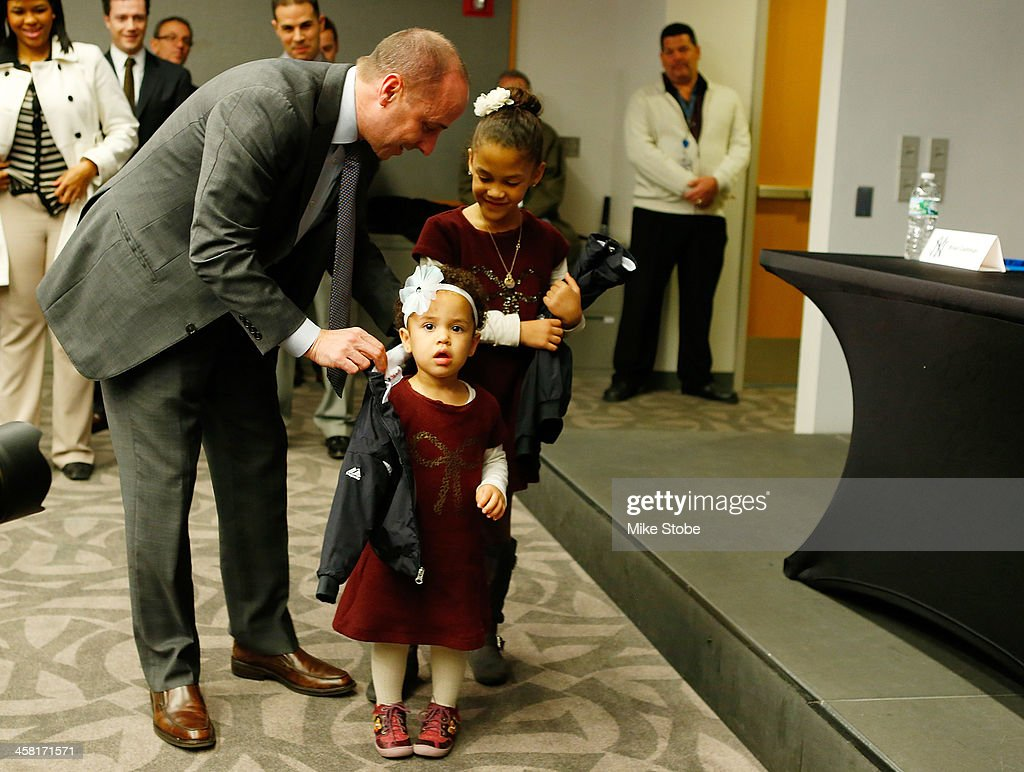 General Manager <a gi-track='captionPersonalityLinkClicked' href=/galleries/search?phrase=Brian+Cashman&family=editorial&specificpeople=234856 ng-click='$event.stopPropagation()'>Brian Cashman</a> presents Carlos Beltran's daughter Ivana and Kiara with Yankee jackets during Beltran's introductory press conference at Yankee Stadium on December 20, 2013 in the Bronx borough of New York City.