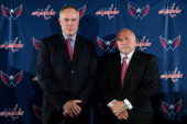 General Manager Brian MacLellan and head coach Barry Trotz both of the Washington Capitals pose following their introductory press conference at the...